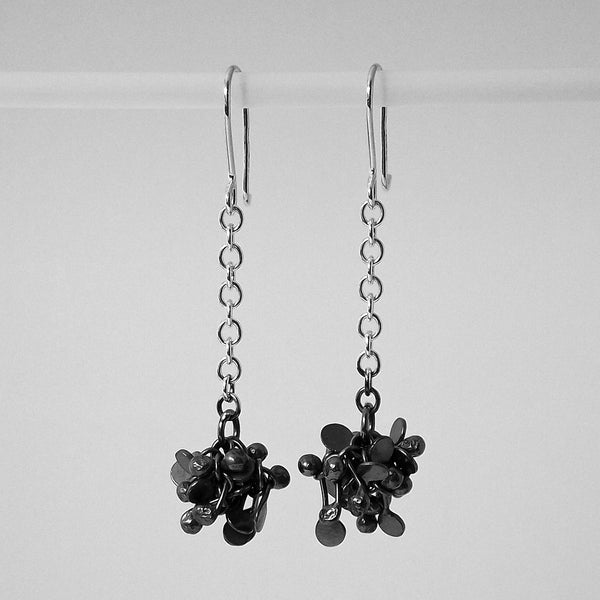 Radiance dangling Earrings, oxidised silver by Fiona DeMarco