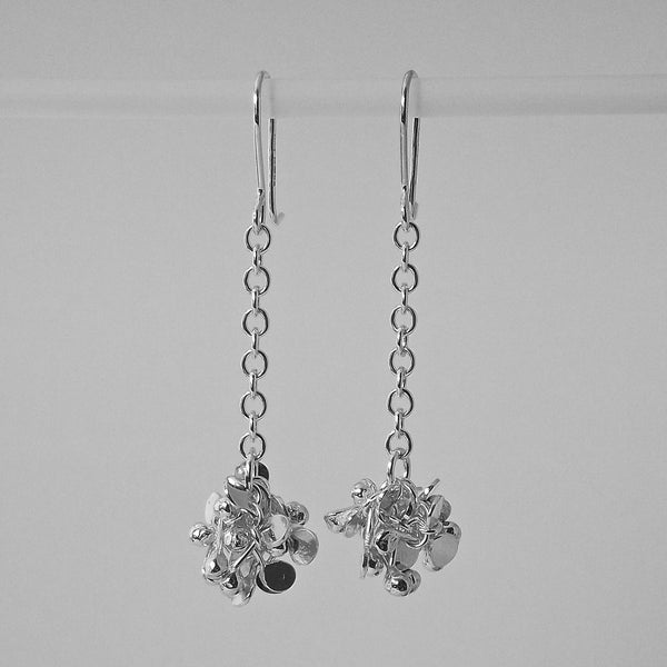 Radiance dangling Earrings, polished silver by Fiona DeMarco