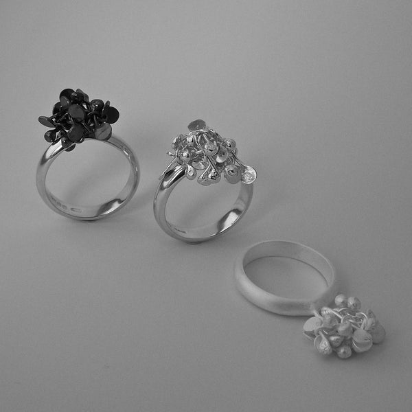 Radiance Rings, oxidised, polished and satin silver by Fiona DeMarco