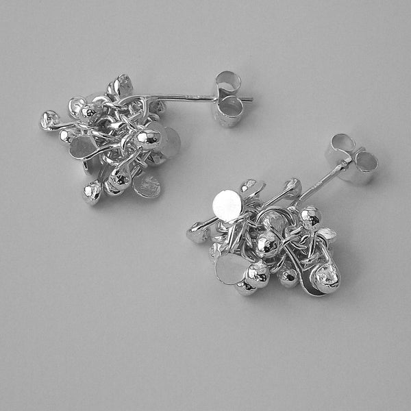 Radiance stud Earrings, polished silver by Fiona DeMarco