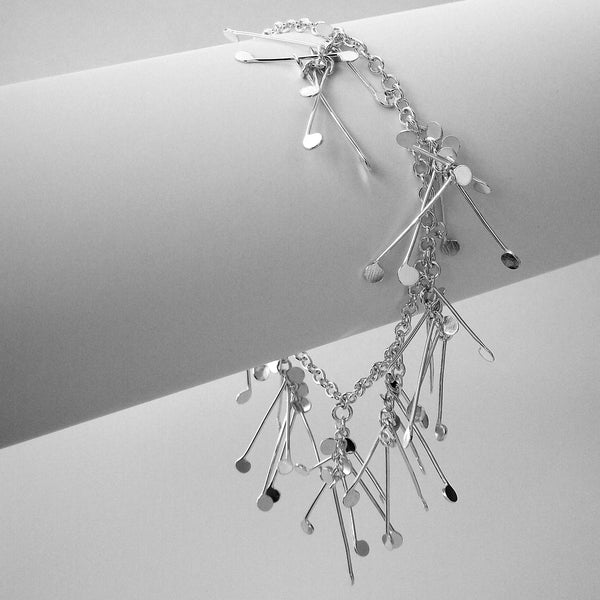 Signature charm Bracelet, polished silver by Fiona DeMarco