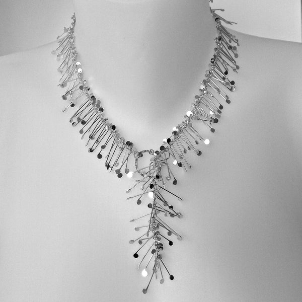 Signature lariat Necklace, polished silver by Fiona DeMarco
