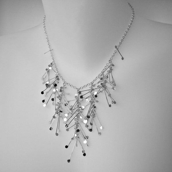 Signature semi graduated Necklace, polished silver by Fiona DeMarco