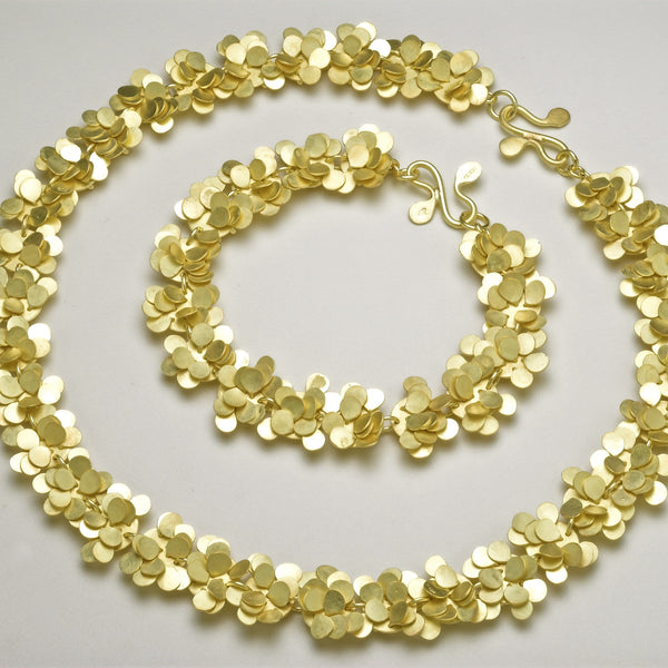 Symphony Precious Necklace and Bracelet, 18ct yellow gold satin by Fiona DeMarco