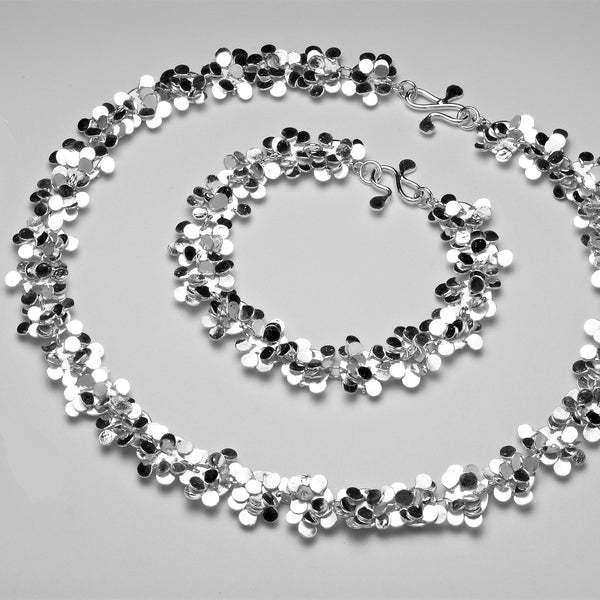 Symphony Bracelet and Necklace, polished silver by Fiona DeMarco