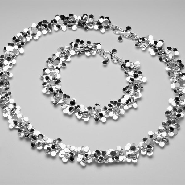 Symphony Necklace and Bracelet, polished silver by Fiona DeMarco