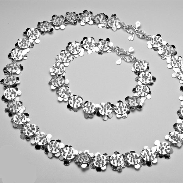 Symphony Bracelet and Necklace reverse side, polished silver by Fiona DeMarco