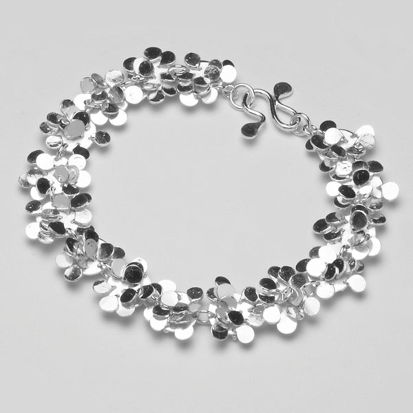 Symphony Bracelet, polished silver by Fiona DeMarco
