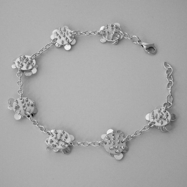 Symphony charm Bracelet reverse side, polished silver by Fiona DeMarco