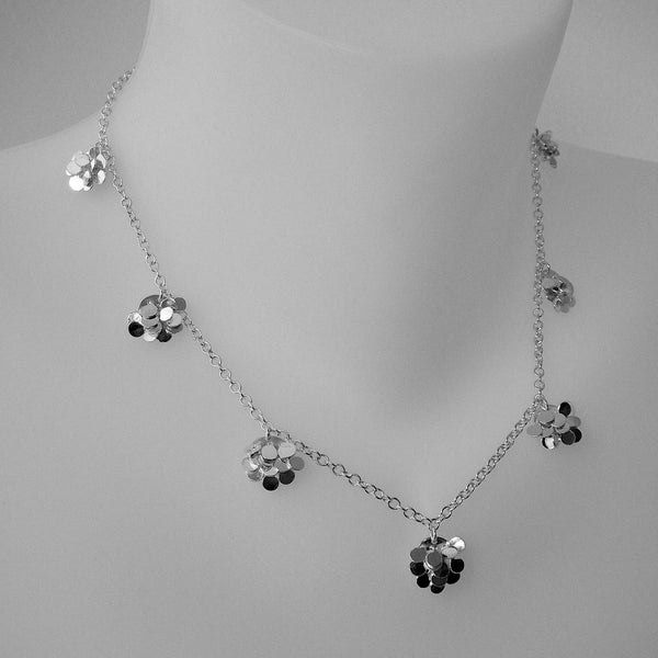 Symphony charm Necklace, polished silver by Fiona DeMarco