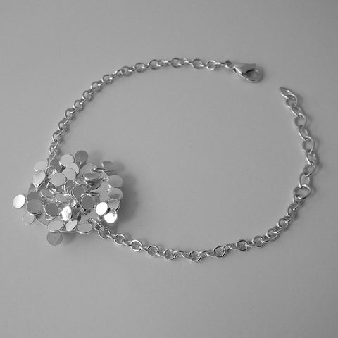 Symphony disc Bracelet, polished silver by Fiona DeMarco