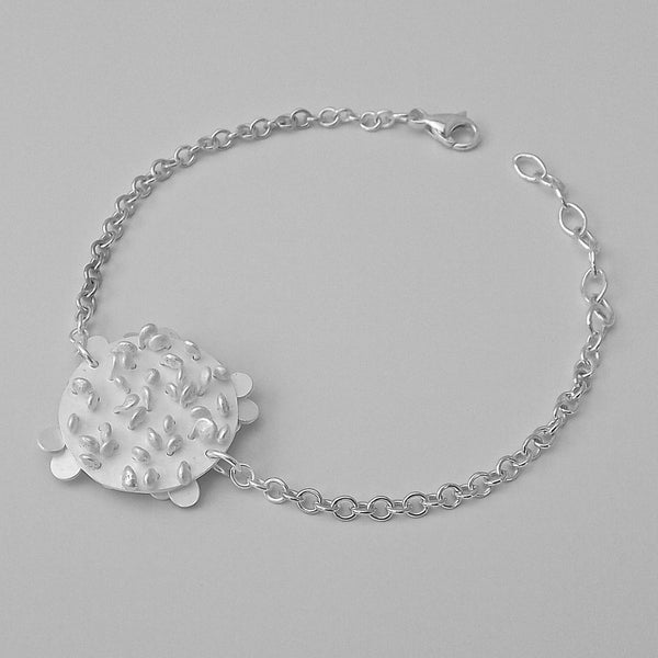 Symphony disc Bracelet reverse side, satin silver by Fiona DeMarco