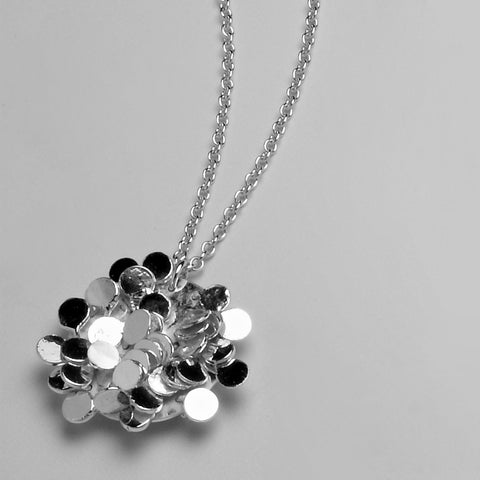 Symphony Pendant, polished silver by Fiona DeMarco