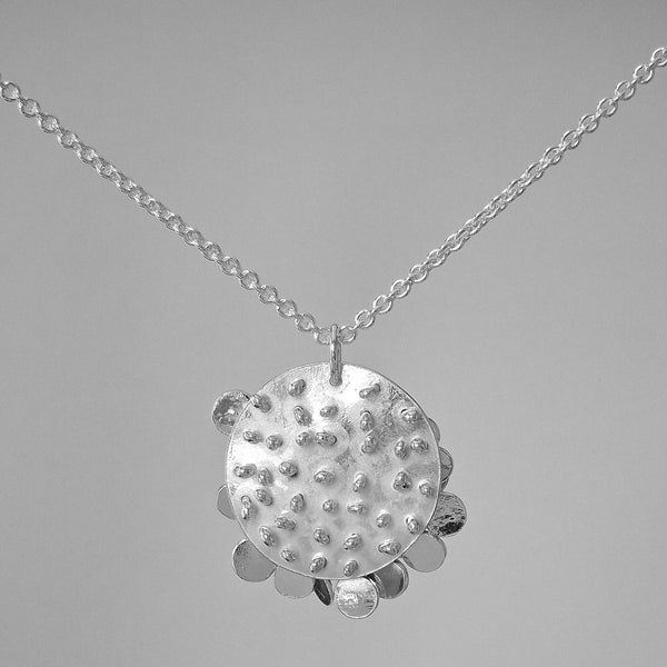 Symphony Pendant reverse side, polished silver by Fiona DeMarco
