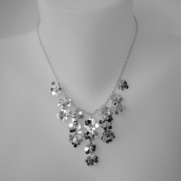 Symphony semi graduated Necklace, polished silver by Fiona DeMarco