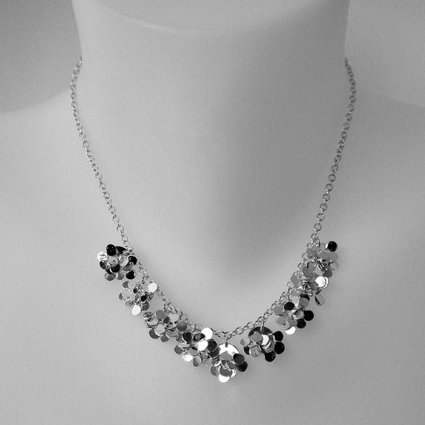 Symphony semi Necklace, polished silver by Fiona DeMarco
