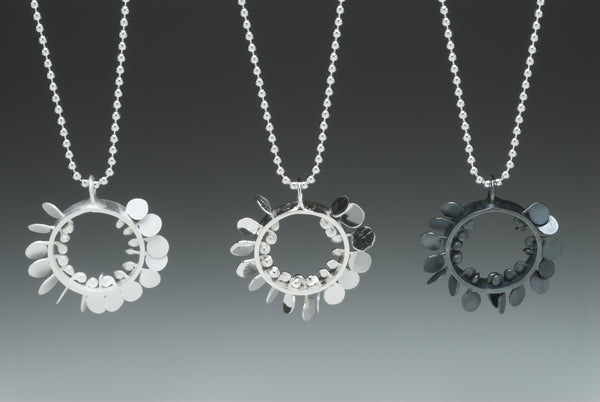 Icon Pendants, satin, polished and oxidised silver by Fiona DeMarco