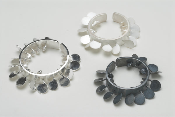 Icon Rings, satin, oxidised and polished silver by Fiona DeMarco