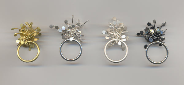Signature Cluster rings, gold and silver by Fiona DeMarco