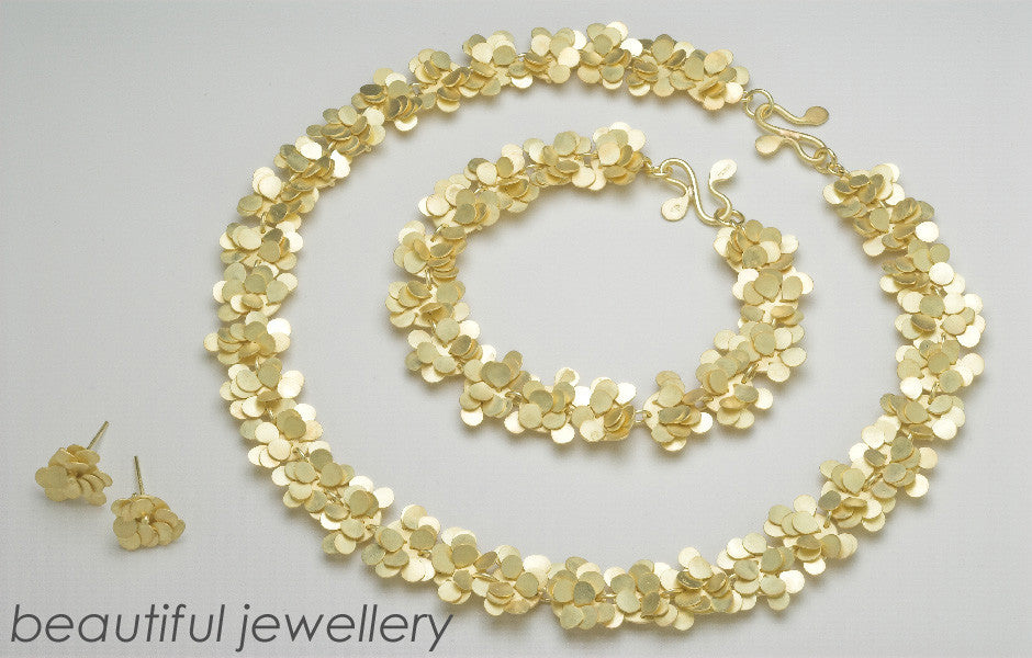 Homepage slideshow Symphony Precious necklace bracelet and earrings 18ct yellow gold satin by Fiona DeMarco