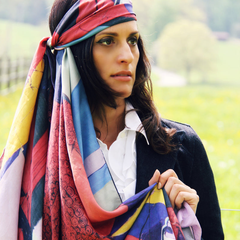Model wearing Chetna Singh Multi Color Buddha Face Square Silk Scarf.