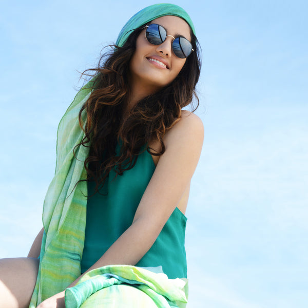 Model wearing Chetna Singh green tie-dye print cotton scarf.