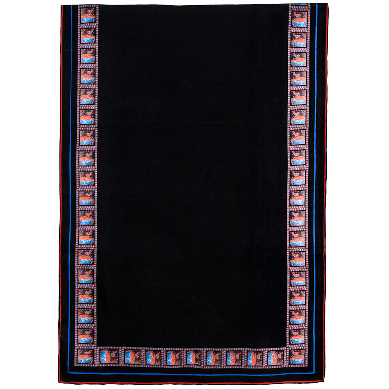 Chetna Singh black silk scarf with Buddha print trim.