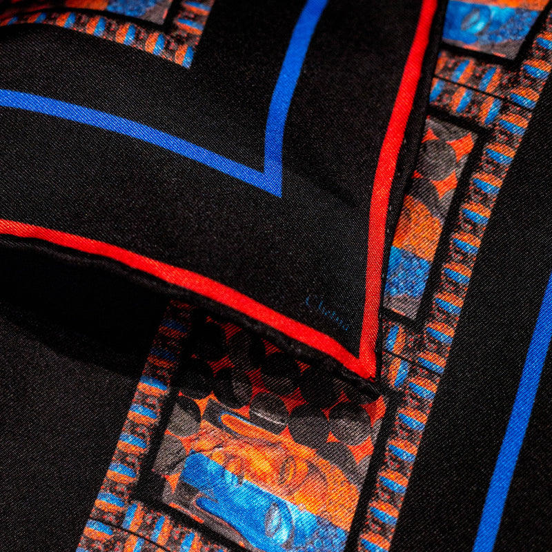 Close-up of Chetna Singh black silk scarf with Buddha print trim.