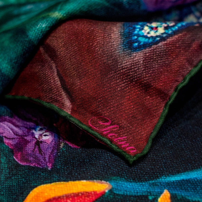 Close-up of Chetna Singh bold jewel tone bird and floral print long silk scarf.