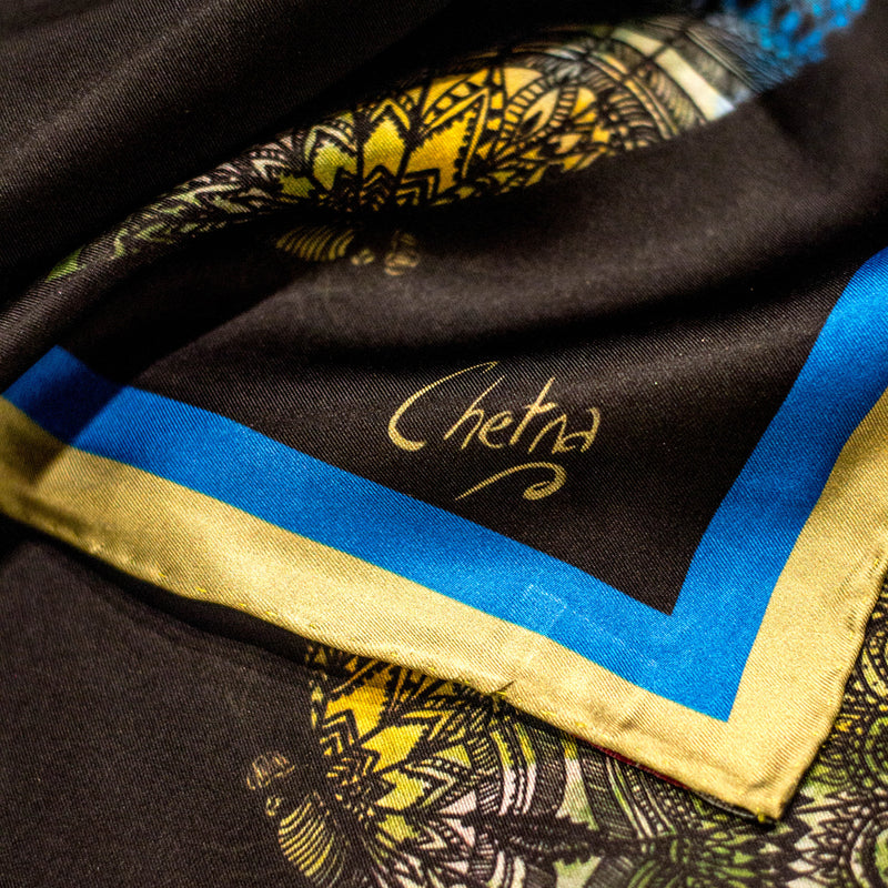 Close-up of Chetna Singh black butterfly print long silk scarf.