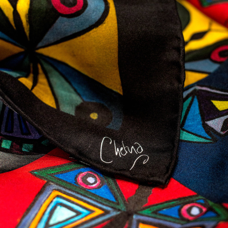 Close-up of Chetna Singh multi-color butterfly print silk scarf.