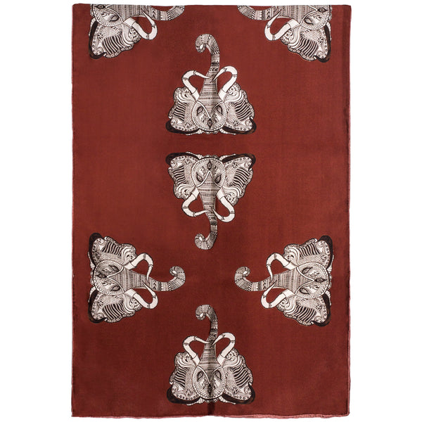 Chetna Singh orange and rust tone elephant print long silk scarf.
