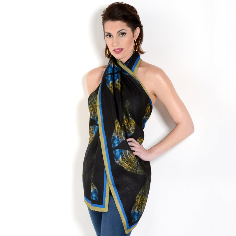 Model wearing Chetna Singh black butterfly print long silk scarf.