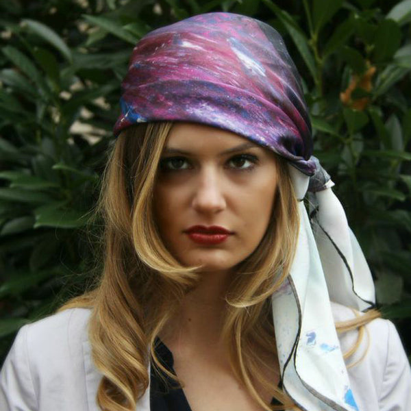 Model wearing Chetna Singh white and purple horse print square silk scarf.