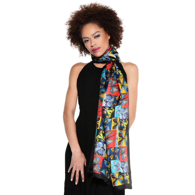 Model wearing Chetna Singh multi-color butterfly print silk scarf.