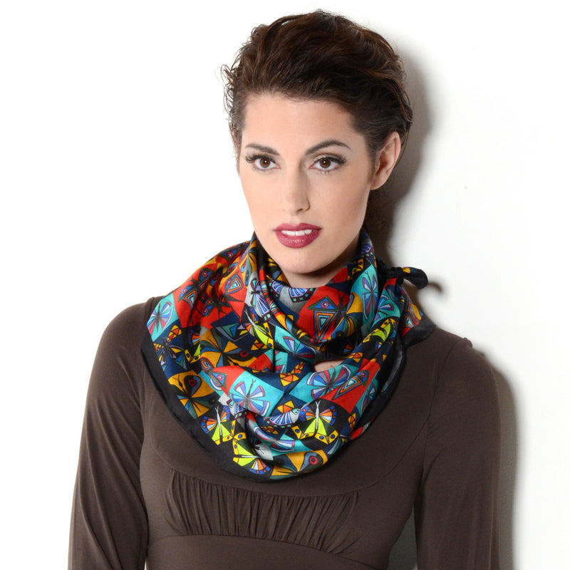 Model wearing Chetna Singh multi-color butterfly print square silk scarf.