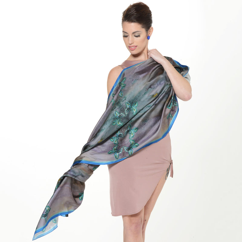 Model wearing Chetna Singh jewel tone butterfly print long silk scarf.