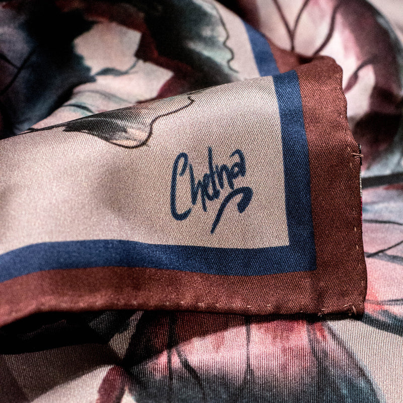 Close-up of Chetna Singh grey butterfly print square silk scarf.