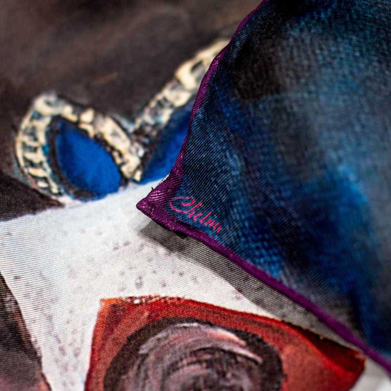 Close-up of Chetna Singh blue tone Venetian woman in mask print silk scarf.