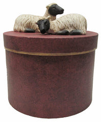PAIR OF SHEEP ON ROUND BOX