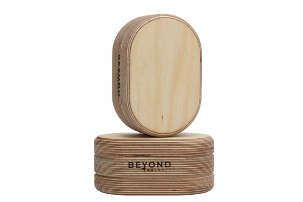 Wood balance blocks in oval shape with Beyond Balance logo