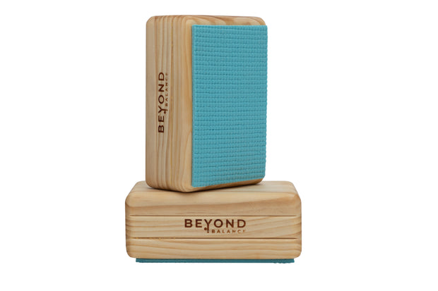 Wood balance blocks with non-slip mat and Beyond Balance logo