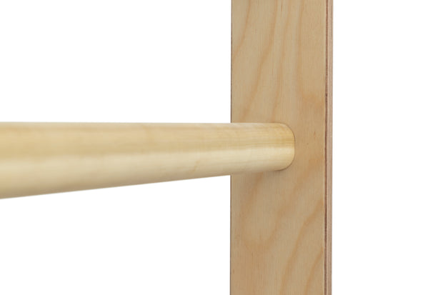 Schroth Method Swedish Wall Bar for Scoliosis Therapy: Oval hardwood dowel close up.