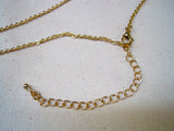 Gold tone necklace with U.T. latitude and longitude