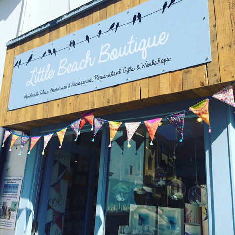Colourful festival bunting outside our new shop front