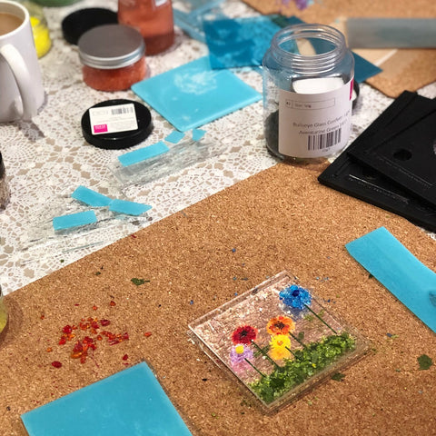 Assembling a glass flower tile in our fused glass workshop