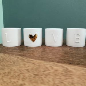 Set of Four Porcelain Love Lights
