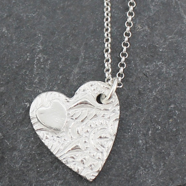 Sterling silver textured double heart pendent