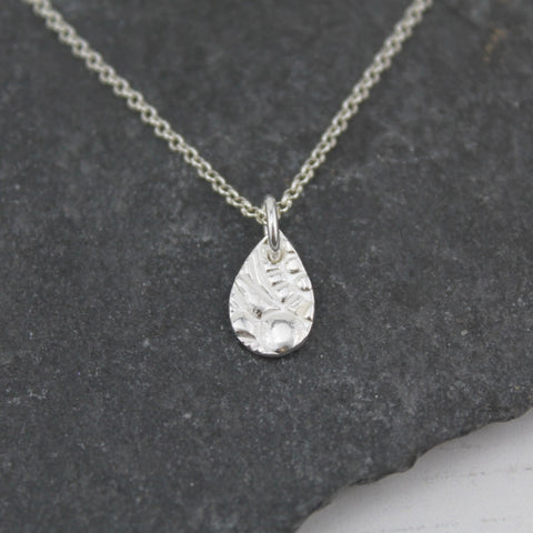 Sterling silver lace textured teardrop pendent