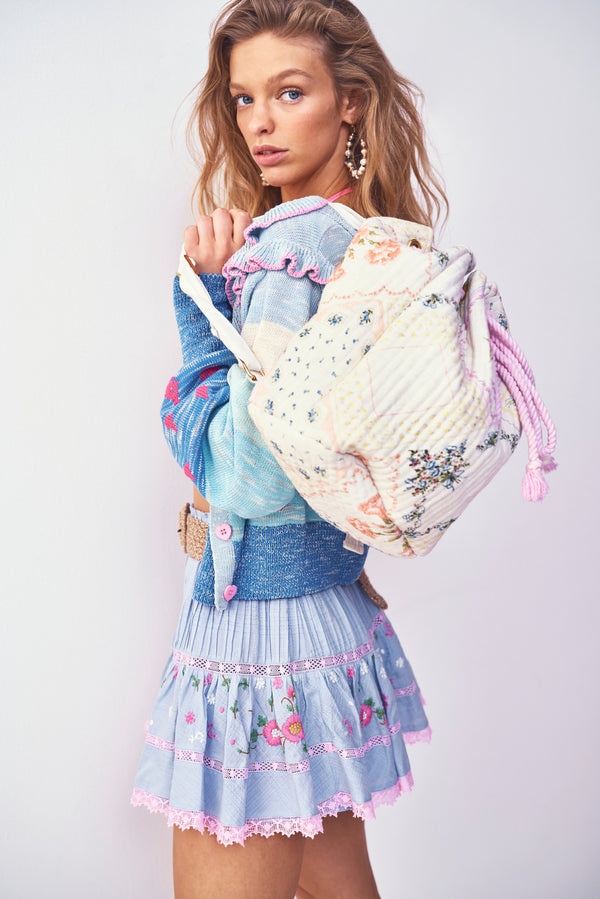 Blue tiered mini skirt with pink embroidery detail and elastic waist